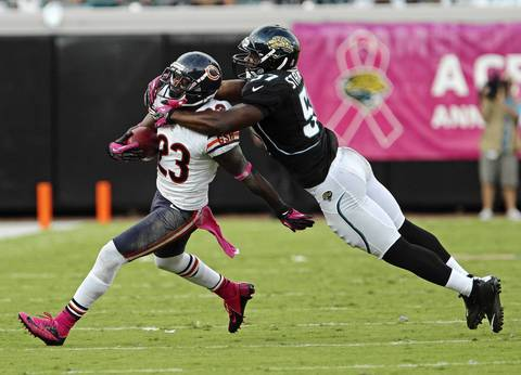 Devin Hester is tackled by the Jaguars' Julian Stanford after making a reception in the third quarter.
