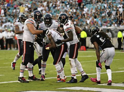 Bears teammates mob Alshon Jeffery after his touchdown against the Jaguars during the second half.