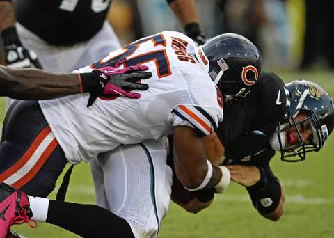 Linebacker Lance Briggs sacks Jaguars quarterback Blaine Gabbert during the second half.