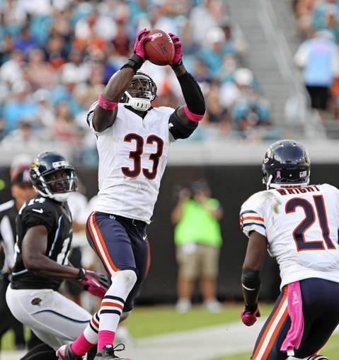 Charles Tillman intercepts a pass by Jaguars quarterback Blaine Gabbert for a touchdown in the third quarter.
