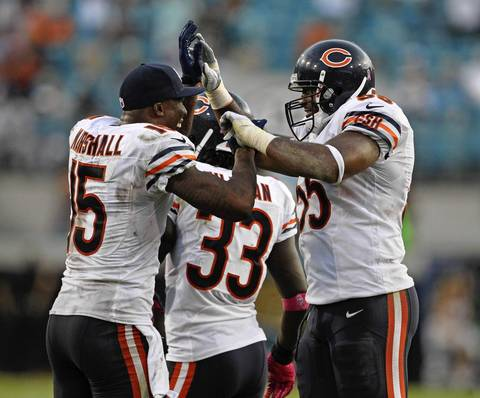 Brandon Marshall celebrates with Lance Briggs after Briggs' interception followed by a touchdown against the Jaguars during the fourth quarter.