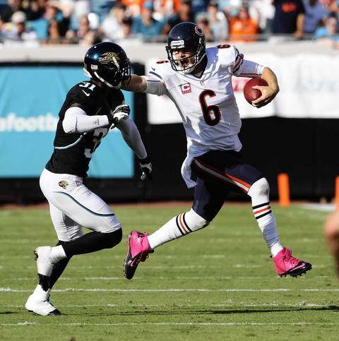 Quarterback Jay Cutler runs for 15 yards away from Jaguars cornerback Aaron Ross for a first down during the second quarter.