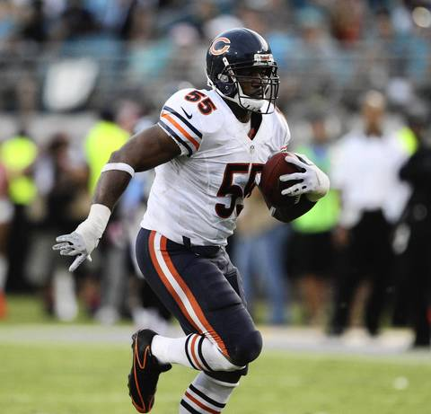 Lance Briggs returns his interception for a touchdown against the Jacksonville Jaguars during the fourth quarter.