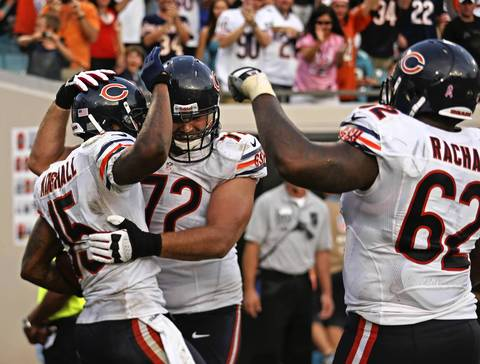 Brandon Marshall celebrates his touchdown with Gabe Carimi and Chilo Rachal during the second half.