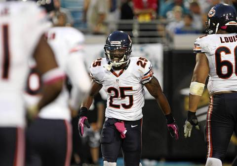 Running back Armando Allen smiles after scoring a touchdown in the fourth quarter at EverBank Field.