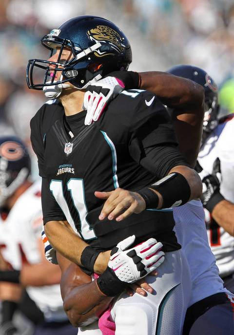 Jaguars quarterback Blaine Gabbert is tackled by Corey Wootton in the second quarter.