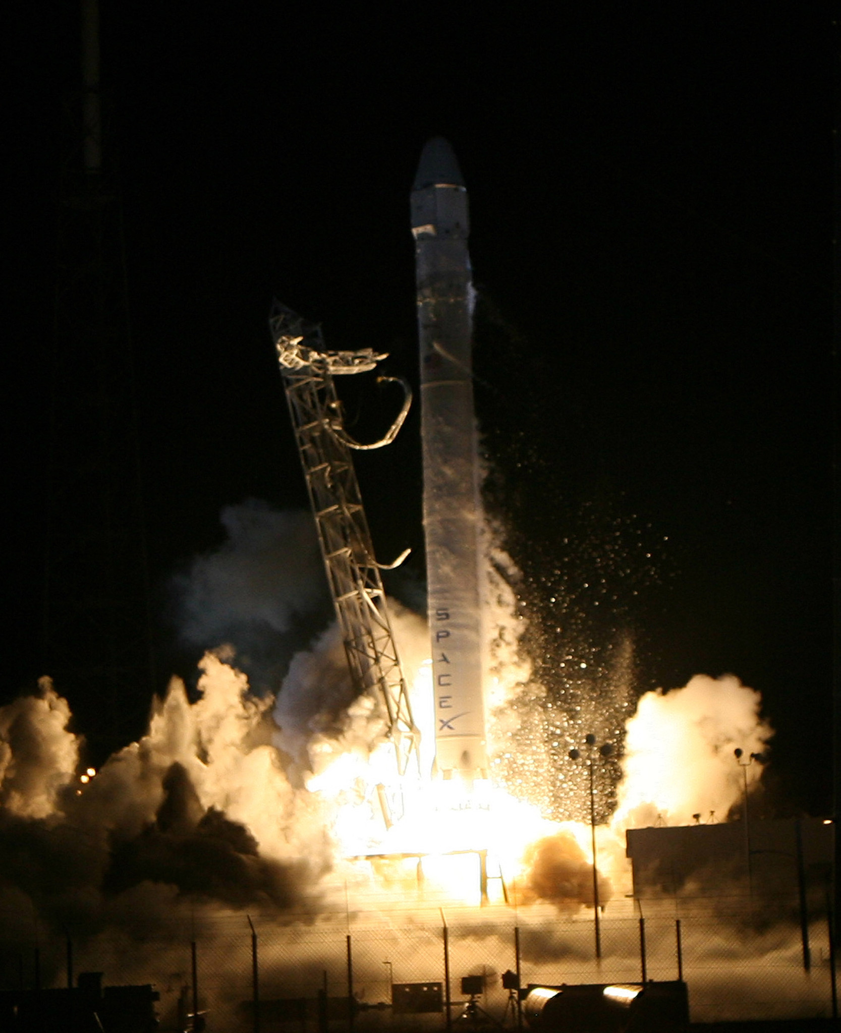 A Falcon 9 rocket carrying a Dragon capsule blasts off on a historic launch from Cape Canaveral Air Force Station.