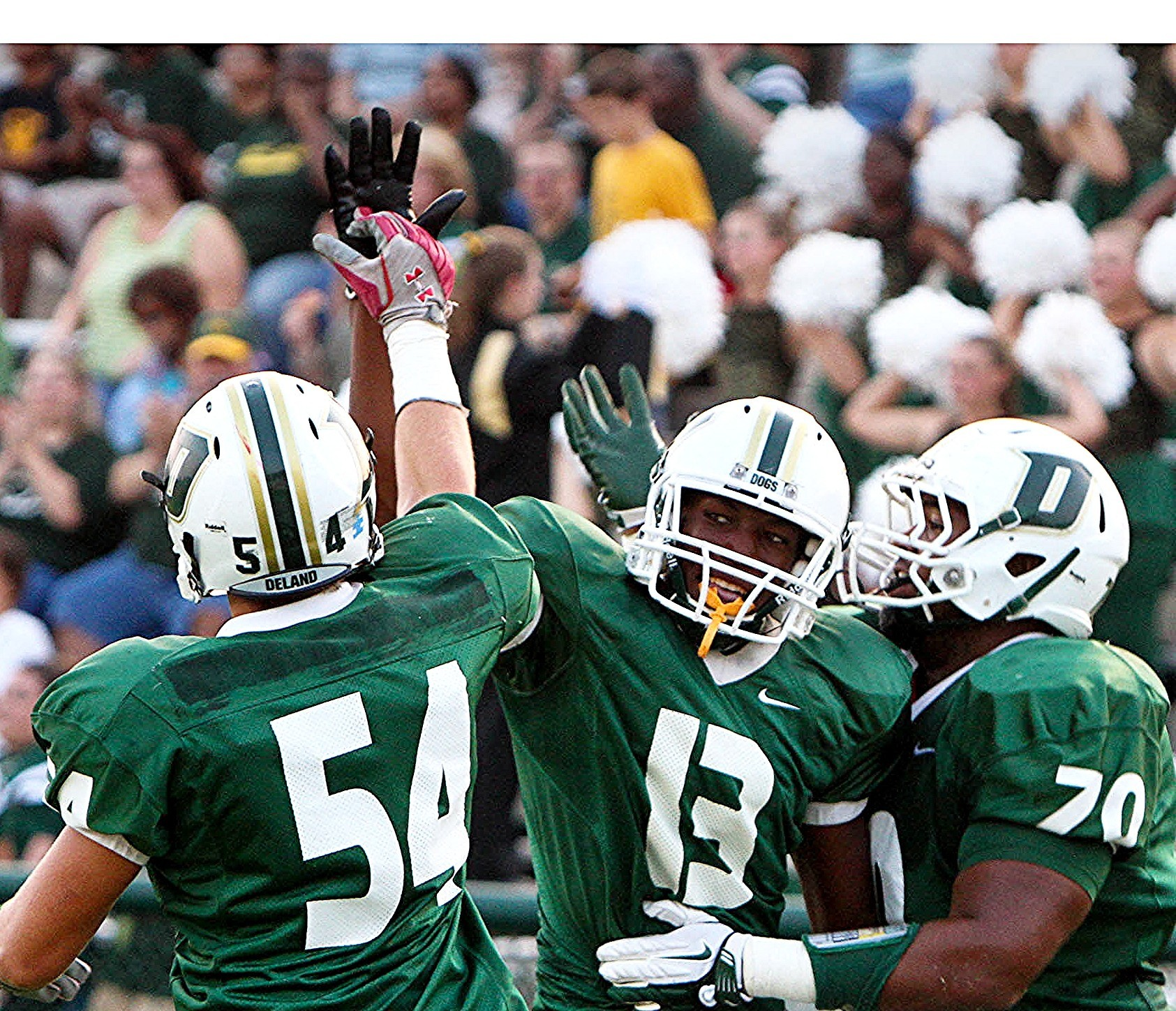 DeLand WR Dantwuan O'Neal is congratulated by teammates after catching a touchdown pass last season. (September 16, 2011)