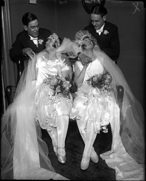 Mr Edwin J. Bissler, left, and Mr. Albert M. Bissler stand behind their brides, Mrs. Edwin J Bissler and Mrs. Albert M. Bissler, on November 27, 1925.