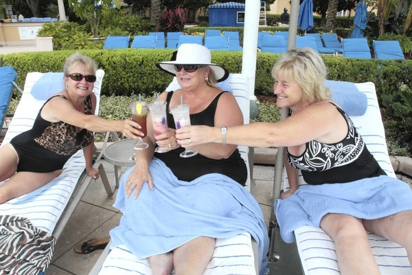 Sue Henderson, Brenda Davis and Lynda Barrett, left to right, vacation at Grand Lakes resort near Orlando Tuesday, October 9, 2012. The friends meet annually while their husbands attend a convention.