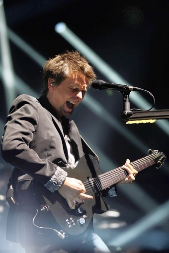 "The singer of British rock band Muse, Matthew Bellamy, performs on stage on October 2, 2012 at the Olympia concert hall in Paris. The band released last week its sixth album entitled ""The 2nd Law"", inspired by the movies music dubstep from the 80's."