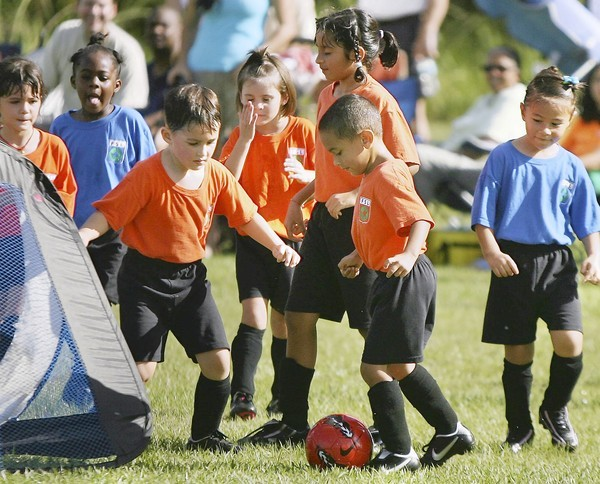 Youngsters compete during soccer practice in a field off U.S. Highway 17-92 in Longwood recently. (Stephen M. Dowell, Orlando Sentinel)