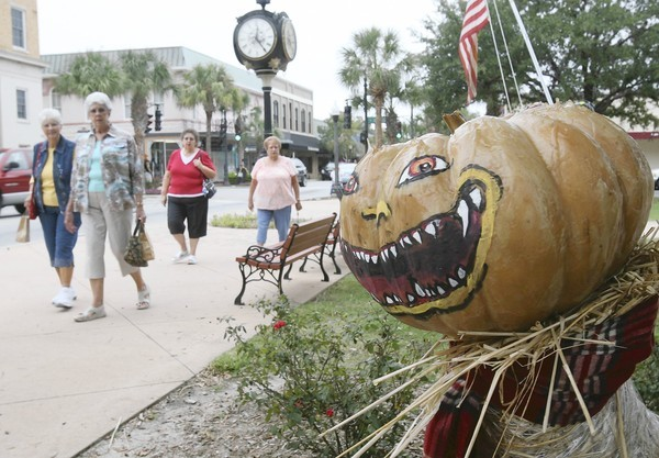 Scarecrows decorate downtown Leesburg streets on Tuesday, October 9, 2013. The scarecrows are part of the  fourth annual Scarecrow Expo & Build Off sponsored by the Leesburg Partnership.  (Tom Benitez/Orlando Sentinel)