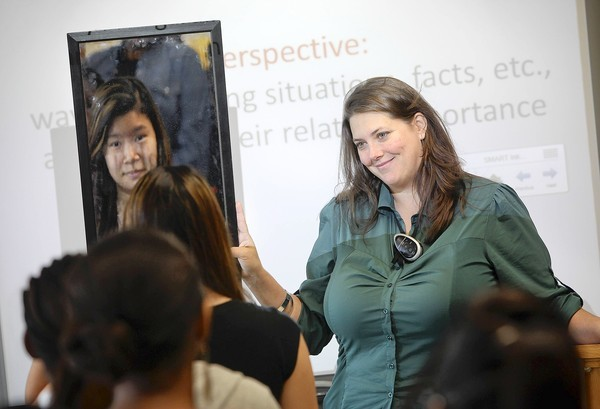 Student Dianna Luu looks in a mirror during a class exercise with Evans High School teacher Jennifer Bohn.