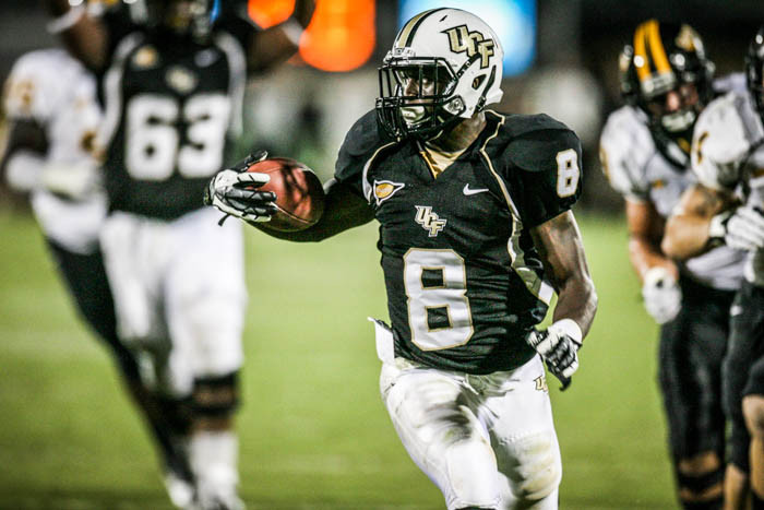 University of Central Florida running back Storm Johnson (8) evades Southern Miss' Jamie Collins (8) and Emmanuel Johnson (12) to run for a touchdown during fourth quarter action of a C-USA football game against Southern Miss at the Brighthouse Networks Stadium on Saturday, October 13, 2012 in Orlando, FL.