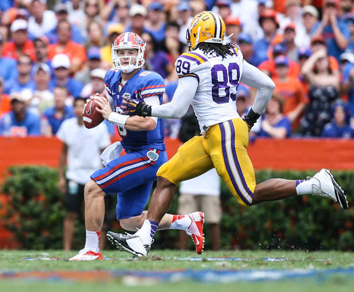 Florida quarterback Jeff Driskel (6) scrambles to evade LSU's Lavar Edwards (89) during first quarter action of their game against LSU at Ben Hill Griffin Stadium on Saturday, October 06, 2012 in Gainesville, FL.