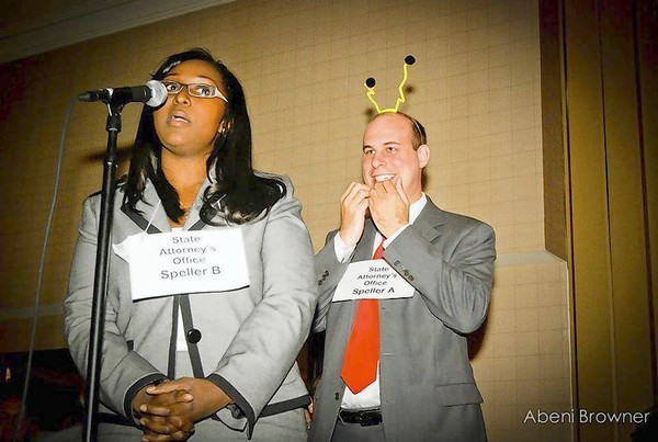 Spellers from the state attorney's office compete in the Lawyers for Literacy Spelling Bee