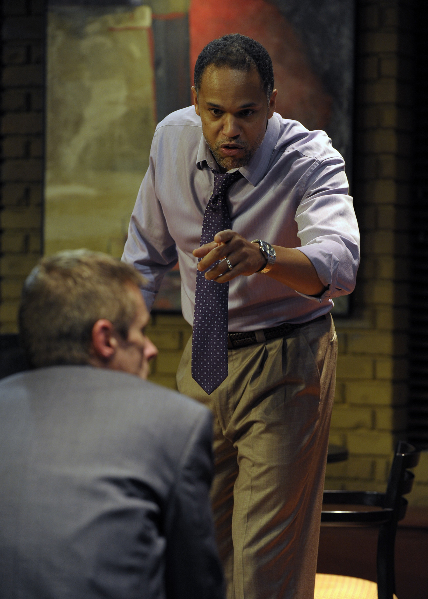 "Lawyer Henry (Keith Hamilton Cobb) makes a point to his partner, Jack (Richard B. Watson, seated) in ""Race."""