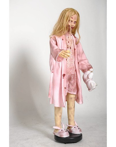 "LIttle zombie girl with teddy bear from TV's ""The Walking Dead"" is one of the hot new items for Halloween this year."