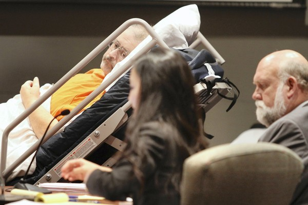 Defendent Kevin Satterfield, a bedridden diabetic, attends his trial in a hospital bed, with his defense attorneys Robert Wesley (right) and Catherine Chien, at the Osceola Courthouse, Tuesday, October 16,  2012. Satterfield is on trial for the shooting death his wife and his pregnant daughter's boyfriend, in April, 2012.   (Joe Burbank/Orlando Sentinel)   newsgate ID#   B582447849Z.1
