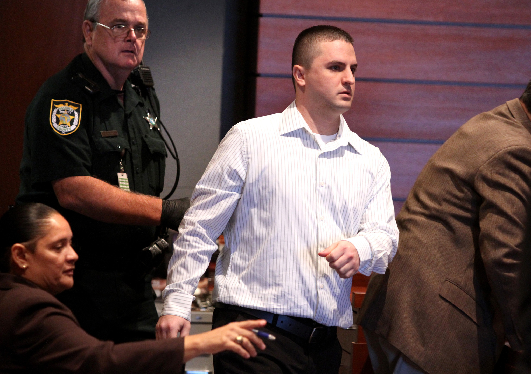 Accused gunman Jason Clair arrives in court for the first day of his trial, at the Osceola County courthouse in Kissimmee, Monday, October 22, 2012. Clair is charged with two counts of first-degree murder in the fatal shooting of brothers Joel and James E. Kun Jr. outside Lenz Dug-Out Pub in June.