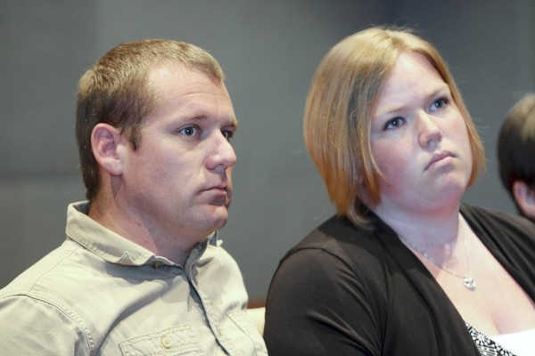 Mark McGowan and Jennifer McGowan -- Accused members of the American Front white supremacy group attend a trial conference in September. All charges against them have now been dropped. (Ricardo Ramirez Buxeda / Orlando Sentinel)