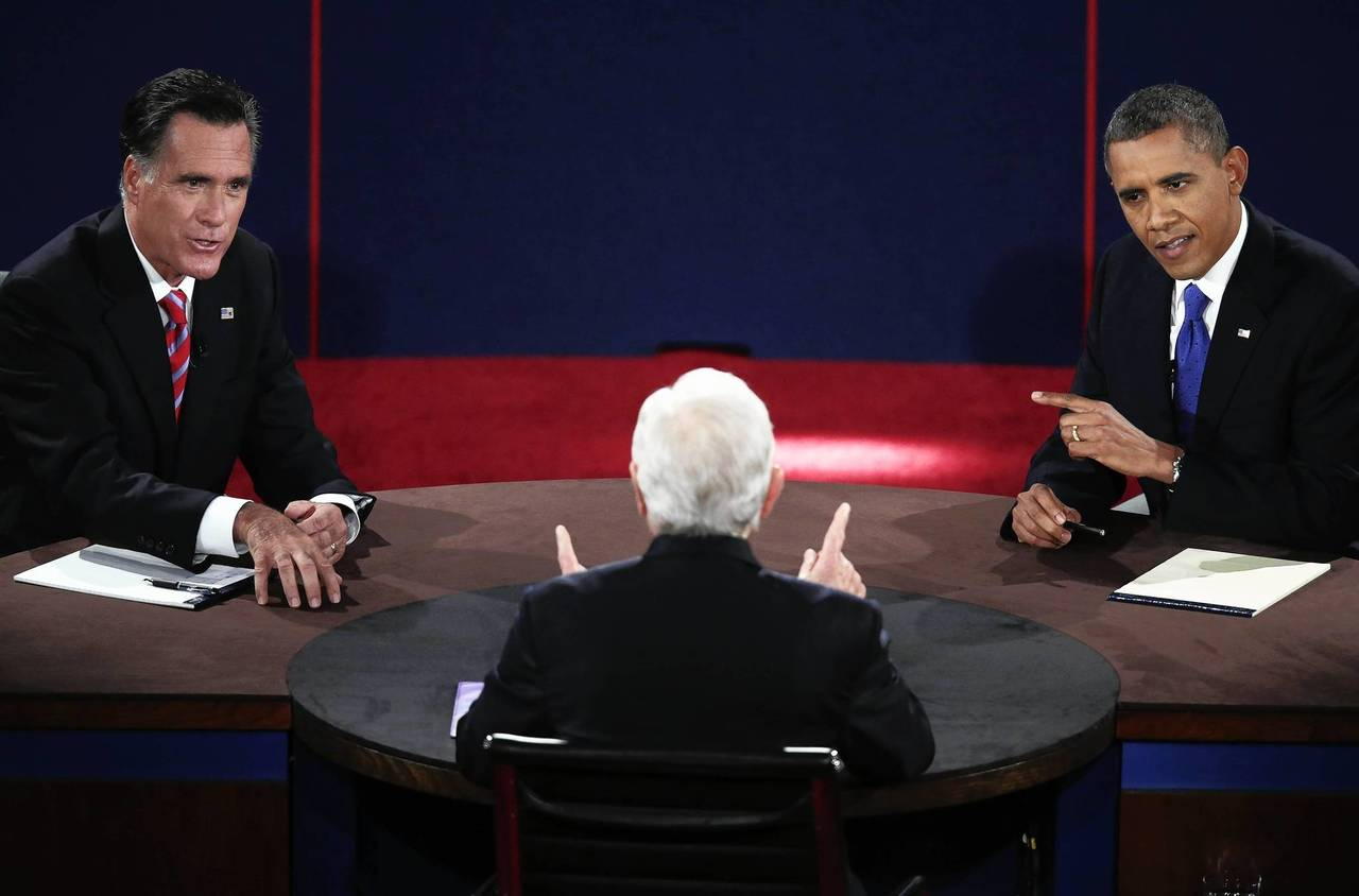 U.S. Republican presidential nominee Mitt Romney (L) and President Barack Obama debate in front of moderator Bob Schieffer during the final U.S. Presidential debate in Boca Raton, Florida