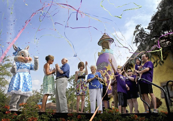 Confetti flies as founder Henri Landwirth helps unveil the Star Tower at Give Kids the World Village on May 14, 2011. Also on stage: Pam Landwirth, left, GKTW President, Alyssa Pietruszka and Henri's twin sister, Margot. Alyssa, now 13, was  3 when she visited the village with stage-3 kidney cancer.
