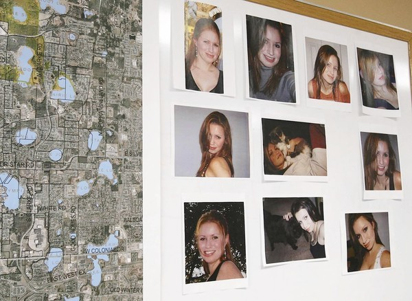 A board showing search areas and photos are on the wall at the police department during a press conference on the first anniversary of the disappearance of Tracy Ocasio at the Ocoee Police Department.