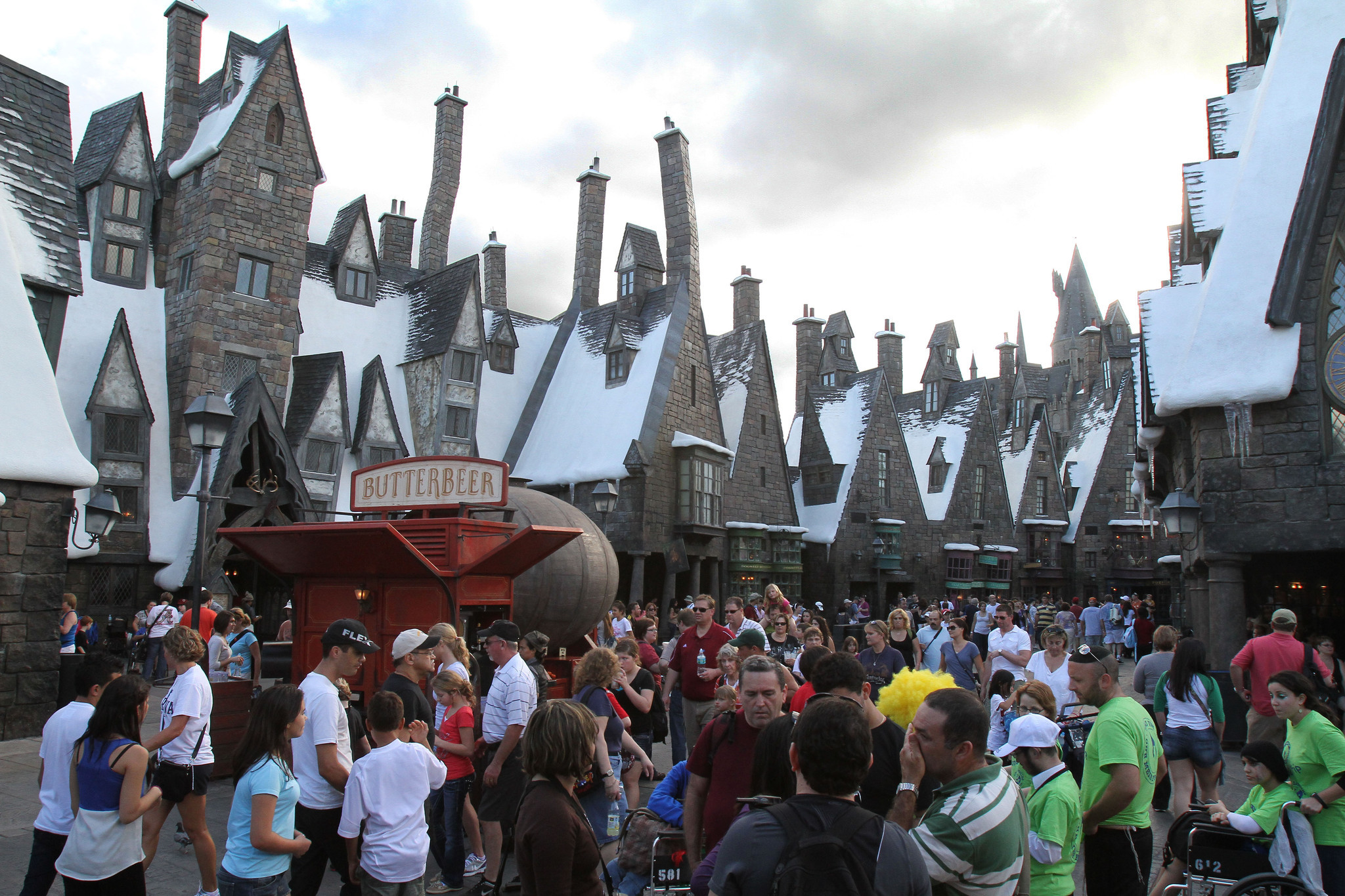 Tourists and Harry Potter enthusiasts jam Hogsmeade Village in the Wizarding World of Harry Potter at Universal's Island of Adventures in Orlando, Fla. Tuesday, December 6, 2011.