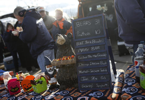A talilgater offers up a pregame prediction while doing some grilling in the parking lot of Soldier Field before the game between the Bears and the Carolina Panthers Sunday.