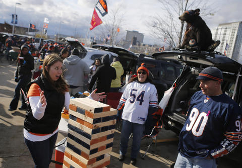 Chicago Bears fan Teresa Wintersdorf plays a giant game of Jenga while tailgating Sunday at Soldier Field.