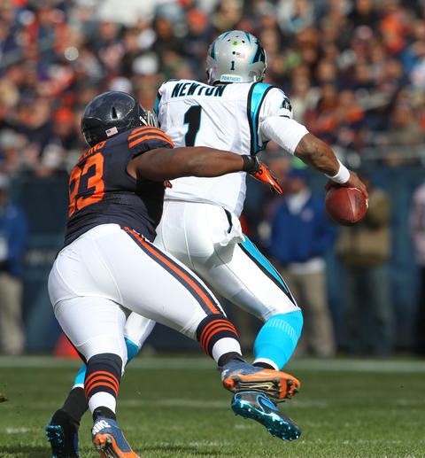 Defensive tackle Nate Collins pressures Panthers quarterback Cam Newton during the first quarter.