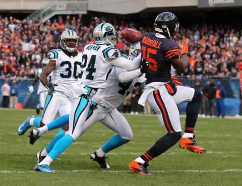 Panthers defensive back Josh Norman intercepts the ball intended for wide receiver Brandon Marshall during the first quarter.