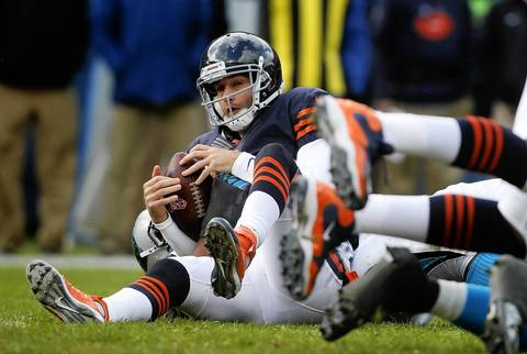 Bears quarterback Jay Cutler is sacked by the Panthers in the second quarter.