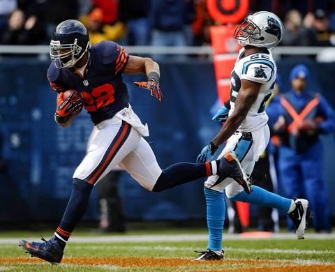 Matt Forte scores a touchdown in front of Panthers defensive back Josh Thomas in the first quarter.