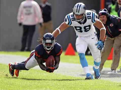 Cornerback Tim Jennings gets an interception in front of Panthers tight end Greg Olsen during the second quarter.