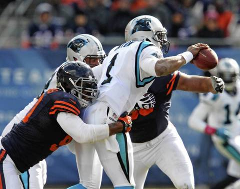 Defensive end Julius Peppers pressures Panthers quarterback Cam Newton and forces him to pass which was intercepted by cornerback Tim Jennings during the second quarter.