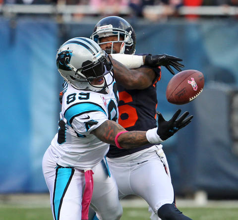 Panthers wide receiver Steve Smith makes a catch in front of cornerback Tim Jennings during the first quarter.
