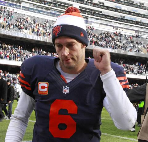 Quarterback Jay Cutler pumps his fist as he leaves the field at the end of his team's win over the Panthers.