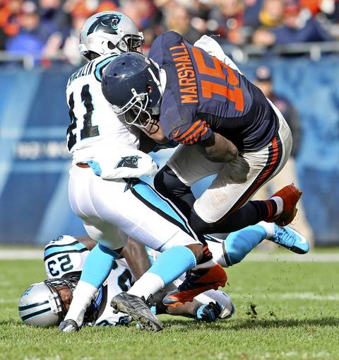 Brandon Marshall with a complete pas in front of Panthers cornerback Captain Munnerlyn during the second half.
