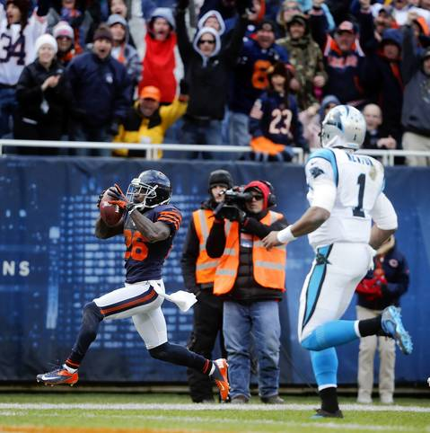 Tim Jennings returns an interception for a touchdown as Panthers quarterback Cam Newton can only watch in the fourth quarter.