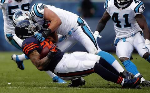 Running back Matt Forte is tackled by Panthers outside linebacker Luke Kuechly.