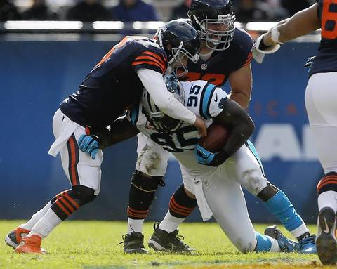 Quarterback Jay Cutler tackles Panthers defensive end Charles Johnson after Johnson picked up Cutler's fumble in the second quarter.