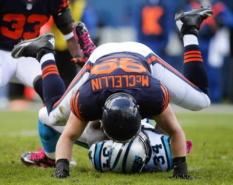Defensive end Shea McClellin tackles Panthers running back DeAngelo Williams for a loss.