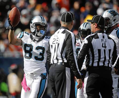 Panthers wide receiver Louis Murphy comes out of the pile after recovering a fumble for a touchdown in the second quarter.