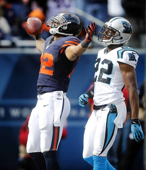 Running back Matt Forte celebrates his touchdown in front of Panthers defensive back Josh Thomas in the first quarter.