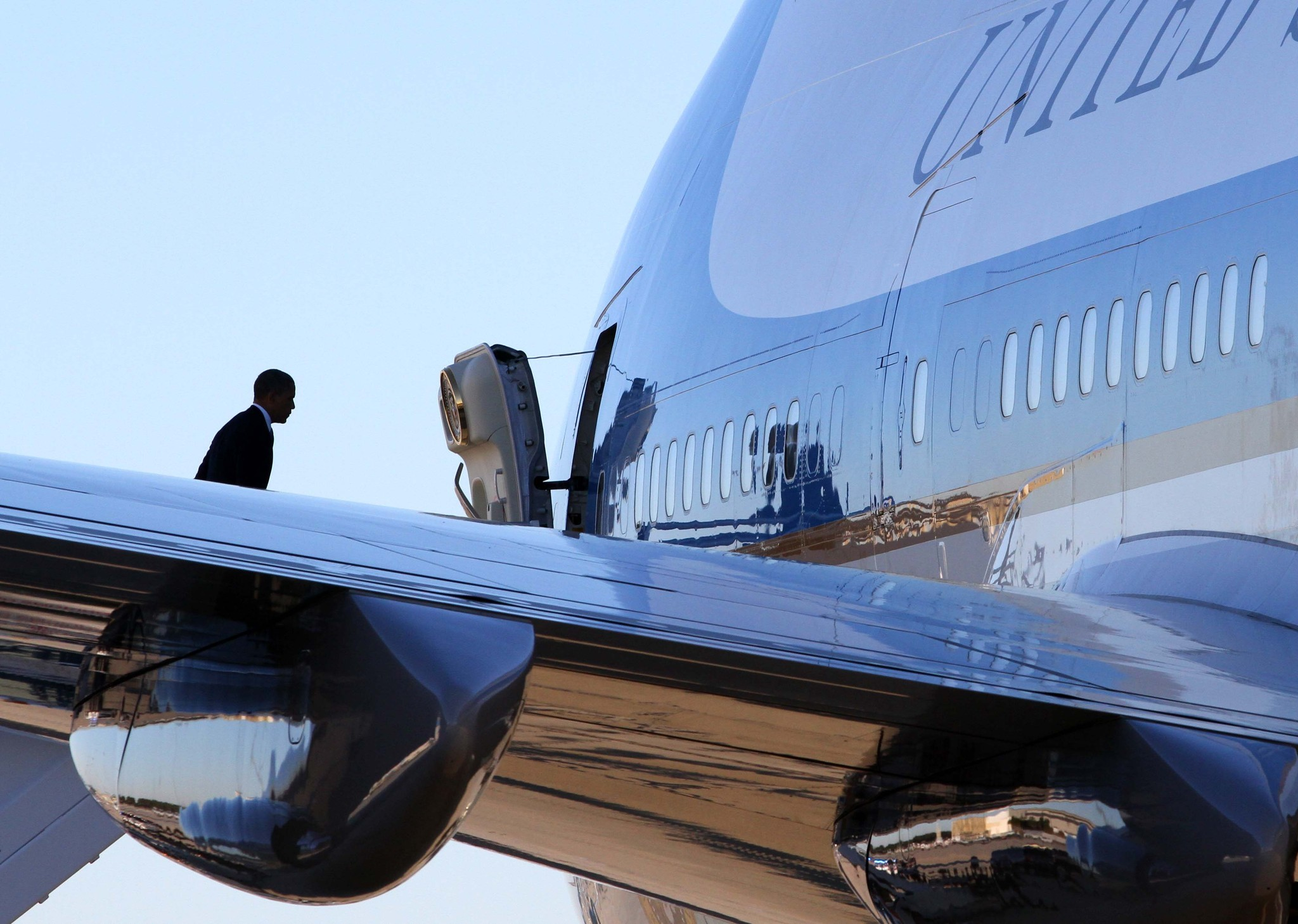 President Barack Obama boards Air Force One at Orlando International Airport after having to cancel his appearance with Bill Clinton at the University of Central Florida, Monday, October 29, 2012. Concerns over strong winds from Hurricane Sandy forced Obama to return to Washington, DC.