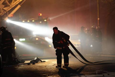 The Chicago Fire Department battles an extra-alarm fire that spread to three buildings on the 8800 block of South Escanaba Avenue in Chicago.