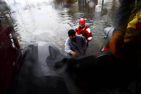 Members of the Atlantic Beach Rescue Department pick up a stranded pedestrian in Island Park because of flooding due to Hurricane Sandy.
